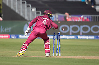 Shai Hope (West Indies) breaks the stumps to run out Kane Williamson (New Zealand) during West Indies vs New Zealand, ICC World Cup Warm-Up Match Cricket at the Bristol County Ground on 28th May 2019
