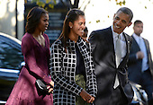 United States President Barack Obama talks with his daughter Malia Obama (L) as they walk from St John's Church to the White House after service in Washington, DC, USA, 27 October 2013.<br /> Credit: Shawn Thew / Pool via CNP