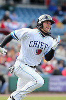 Syracuse Chiefs center fielder Bryce Harper #34 runs to first after hitting a double in his first at bat during the opening game of the International League season against the Rochester Red Wings at Alliance Bank Stadium on April 5, 2012 in Syracuse, New York.  (Mike Janes/Four Seam Images)
