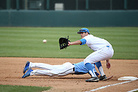 Sean Bouchard (5) of the of UCLA Bruins takes a throw to first base during a game against the University of San Diego Toreros at Jackie Robinson Stadium on March 4, 2017 in Los Angeles, California.  USD defeated UCLA, 3-1. (Larry Goren/Four Seam Images)