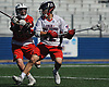 Brady Strough #12 of Cold Spring Harbor, right, gets pressured by Chris Chimera #23 of Floral Park during the Nassau County varsity boys lacrosse Class C semifinals at Shuart Stadium, located on the campus Hofstra University in Hempstead, on Thursday, May 24, 2018.