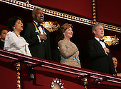 Actors Ruby Dee and Ossie Davis join U.S. first lady Laura Bush and United States President George W. Bush in the presidential box for the singing of the national anthem at the Kennedy Center December 5, 2004 in Washington, DC. Six honorees were saluted for their lifetime contributions to American culture through the performing arts. .Credit: Win McNamee - Pool via CNP