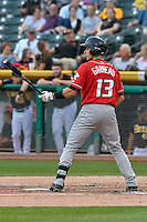 Dustin Garneau (13) of the Albuquerque Isotopes at bat against the Salt Lake Bees in Pacific Coast League action at Smith's Ballpark on August 30, 2016 in Salt Lake City, Utah. The Bees defeated the Isotopes 3-2. (Stephen Smith/Four Seam Images)
