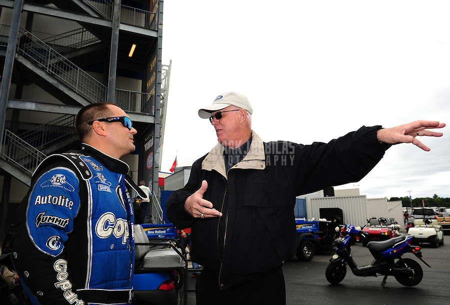 Sept. 18, 2011; Concord, NC, USA: NHRA top fuel dragster driver Brandon Bernstein (left) with NHRA official Graham Light during the O'Reilly Auto Parts Nationals at zMax Dragway. Mandatory Credit: Mark J. Rebilas-