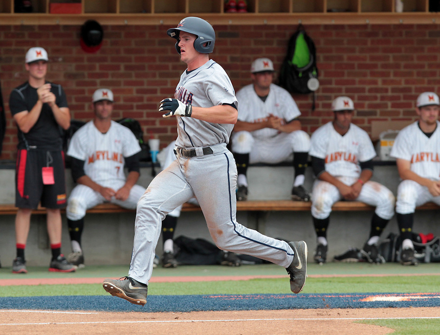 Virginia catcher Robbie Coman (8) scores a run in the third inning of an NCAA college baseball tournament super regional game against Maryland in Charlottesville, Va., Sunday, June 8, 2014. (AP Photo/Andrew Shurtleff)