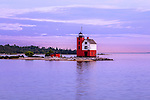 The Historic Round Island Lighthouse just after sunset, as seen ferrying back to Mackinac City from Mackinac Island, Michigan's Lower Peninsula, USA