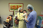 Amal Safaty holds her daughter Asma, 1, during last checks as she waits to be taken to heart surgery in Hadassah Hospital. Asma suffers from Tetralogy of Falot and needs immediate surgery. Photo by Quique Kierszenbaum