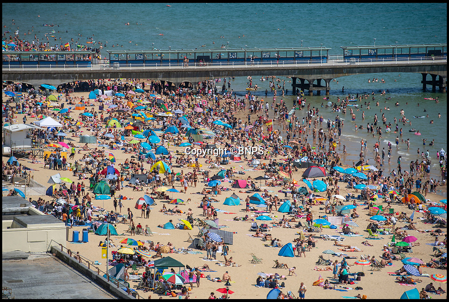 BNPS.co.uk (01202 558833)<br /> Pic: LeeMcLean/BNPS<br /> <br /> Beaches were still packed......<br /> <br /> Sizzling Saturday in Bournemouth as football fever gripped the seaside resort, with fans havng to resort to peering in windows as all the bars were full.