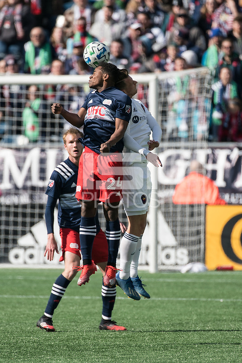 FOXBOROUGH, MA - MARCH 7: DeJuan Jones #24 of New England Revolution and Fabian Herbers #21 of Chicago Fire compete for a head ball during a game between Chicago Fire and New England Revolution at Gillette Stadium on March 7, 2020 in Foxborough, Massachusetts.