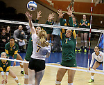 SIOUX FALLS, SD - DECEMBER 8:  Abbie Lynn #7 from Angelo State tries for a kill past a pair of defenders including Leah Swiss #7 from Alaska Anchorage in the Women's Division II Volleyball Championship Thursday at the Sanford Pentagon in Sioux Falls, SD.  (Photo by Dave Eggen/Inertia)