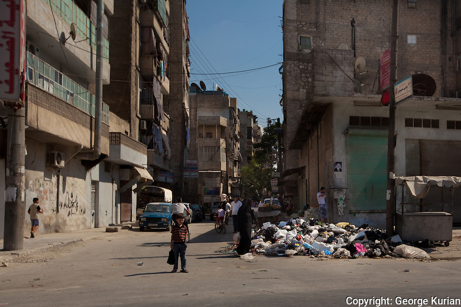 09/08/20l2, Aleppo: Piles of garbage lie in mounds on every street of Aleppo. Residents unsuccessfully try to burn these heaps and the stinking piles grow by the day, increasing the hazard of an epidemic.