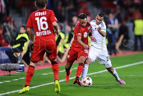 27.08.2014. Leverkusen, Germany. UEFA Champions League qualification match. Bayer Leverkusen versus FC Copenhagen. Tin Jedaj ( Leverkusen ) and Karim Bellarabi ( Leverkusen ) combine to stop  Youssef Toutouh ( Copenhagen )