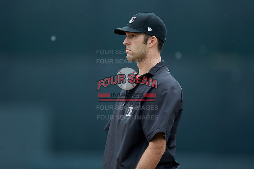 Base umpire Ty Kraus handles the calls on the bases during the Midwest League game between the South Bend Cubs and the West Michigan Whitecaps at Fifth Third Ballpark on June 10, 2018 in Comstock Park, Michigan. The Cubs defeated the Whitecaps 5-4.  (Brian Westerholt/Four Seam Images)