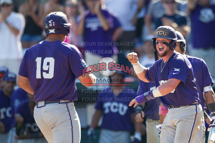 TCU Horned Frogs catcher Evan Skoug (9) greets teammate Luken Baker (19) after his ninth inning 3 run go ahead home run against the Texas Tech Red Raiders in Game 3 of the NCAA College World Series on June 19, 2016 at TD Ameritrade Park in Omaha, Nebraska. TCU defeated Texas Tech 5-3. (Andrew Woolley/Four Seam Images)