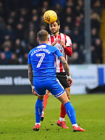 Lincoln City's Sam Habergham heads clear over Notts County's Lewis Alessandra<br /> <br /> Photographer Andrew Vaughan/CameraSport<br /> <br /> The EFL Sky Bet League Two - Lincoln City v Notts County - Saturday 13th January 2018 - Sincil Bank - Lincoln<br /> <br /> World Copyright &copy; 2018 CameraSport. All rights reserved. 43 Linden Ave. Countesthorpe. Leicester. England. LE8 5PG - Tel: +44 (0) 116 277 4147 - admin@camerasport.com - www.camerasport.com