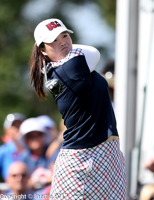 DES MOINES, IA - AUGUST 20: USA's Angel Yin watches her tee shot on the first hole during her singles match Sunday morning at the 2017 Solheim Cup in Des Moines, IA. (Photo by Dave Eggen/Inertia)