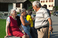 Switzerland. Canton Graubunden. Bregaglia valley. Bondo. The remote village was hit by a huge landslide caused by a giant rockslide swept down from Piz Cengalo on August 23, 2017. The elderly people who had returned to their homes had to be evacuated from the village for the second time due to a new landslide. Silvia Rogati (L), 81 years old, talks to Reto Scartazzini, a retired veterinarian who used to be the mayor of Bondo from 1991 to 1996. 25.08.2017 © 2017 Didier Ruef