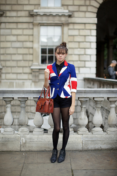 A girl wears a Union Jack jacket at London Fashion Week