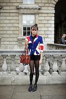 A girl wears a Union Jack jacket at London Fashion Week