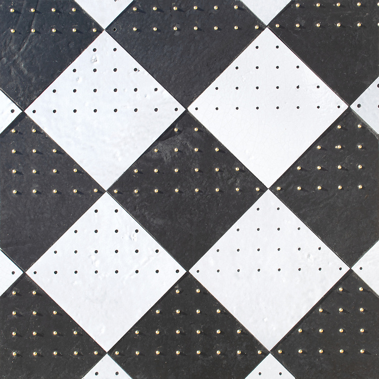 Yorke, a waterjet stone mosaic, shown in honed Orpheus Black, Oleander Basalto, and Brass studs, is part of the Bright Young Things™ collection by New Ravenna.