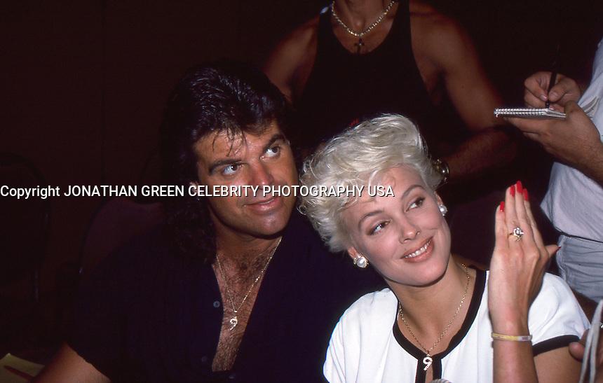 Mark Gastineau & Brigitte Nielsen 1988 by <br /> Jonathan Green