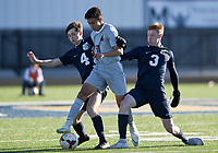 NWA Democrat-Gazette/CHARLIE KAIJO Springdale High School Danny Maldanado (11) dribbles as Bentonville West High School players defend during a soccer game, Friday, March 15, 2019 at Bentonville West in Centerton.