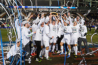 Notre Dame Fighting Irish players pose with the championship trophy. The Notre Dame Fighting Irish defeated the Maryland Terrapins 2-1 during the championship match of the division 1 2013 NCAA  Men's Soccer College Cup at PPL Park in Chester, PA, on December 15, 2013.