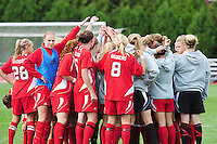 The Wisconsin women's soccer team huddle before the game on Sunday, as the Badgers take on Indiana at the McClimon Soccer Complex in Madison