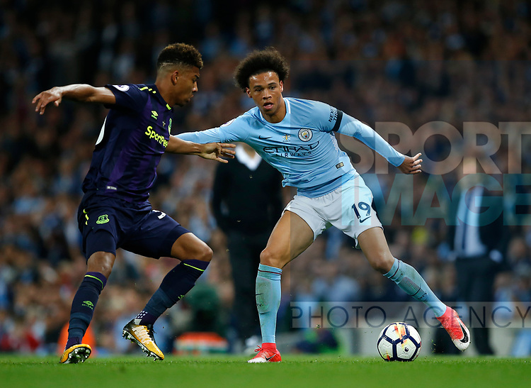 Leroy Sane of Manchester City tussles with Mason Holgate of Everton  during the Premier League match at the Eithad Stadium, Manchester. Picture date 21st August 2017. Picture credit should read: Simon Bellis/Sportimage