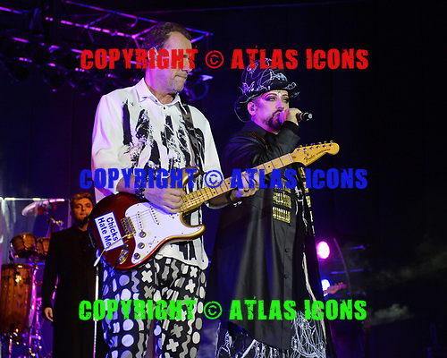 POMPANO BEACH FL - JULY 01: Roy Hay and Boy George of Culture Club perform at The Pompano Beach Amphitheater on July 1, 2018 in Pompano Beach, Florida. Photo by Larry Marano © 2018