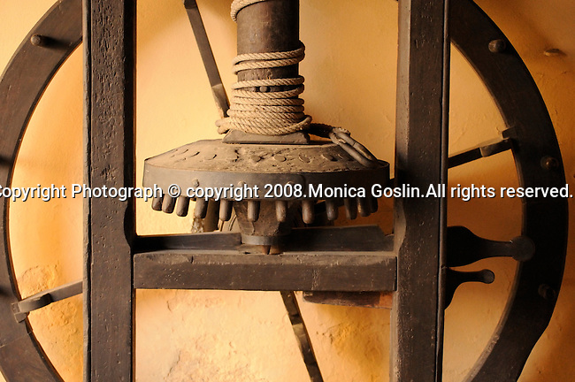 Detail of an antique wine press in the small town of Grandola on Lake Como, Italy