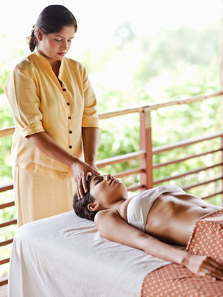 Woman Receiving Marma Point Therapy at Kamalaya, Koh Samui, Thailand. A woman receives Marma Point Therapy, part of the Royal Ayurvedic Massage at the spa overlooking the Gulf of Thailand (Ao Thai) at Kamalaya resort.