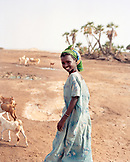 ERITREA, Beilul, a young Afar girl tends to her livestock in Dad Village