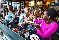 Work & Class restaurant in Denver, Colorado, Thursday, August 17, 2017. Highlighted menu items include the cajun spiced rotisserie chicken, sweet and spicy braised greens, fried sweet plantains, toasted cumin black-eyed pea salad.<br /> <br /> <br /> Photo by Matt Nager
