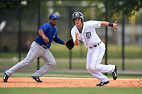 GCL Tigers shortstop Aaron Sayers (1) running the bases as first baseman Juan Kelly (41) breaks towards the bag during a game against the GCL Blue Jays on June 30, 2014 at Tigertown in Lakeland, Florida.  GCL Blue Jays defeated the GCL Tigers 3-1.  (Mike Janes/Four Seam Images)