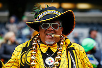 A Pittsburgh Steelers fan poses for a portrait in the stands prior to the game against the Seattle Seahawks at CenturyLink Field on November 29, 2015 in Seattle, Washington. (Photo by Jared Wickerham/DKPittsburghSports)