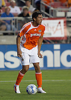 Houston Dynamo's Brian Ching dribbles the ball at Robertson Stadium in Houston, TX on Saturday May 6, 2006. The Houston Dynamo defeated FC Dallas 4-3.