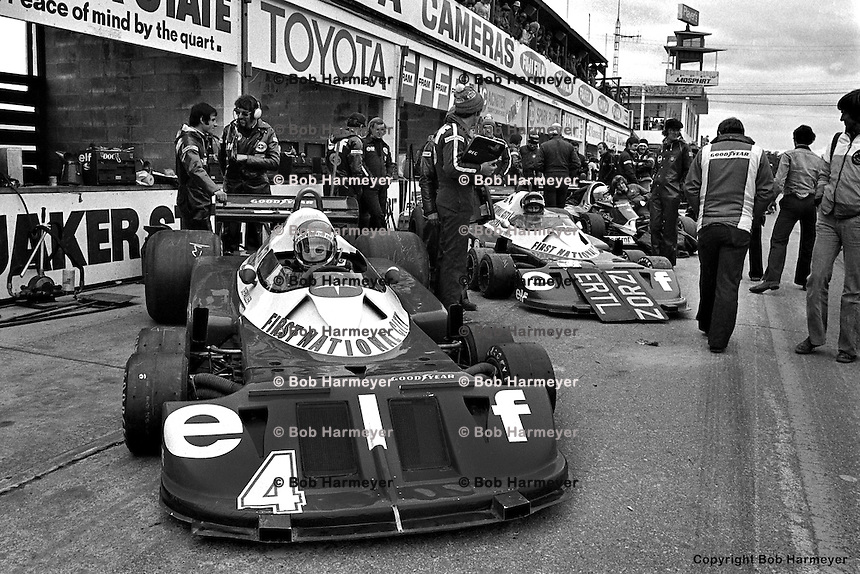 BOWMANVILLE, ONT - OCTOBER 9: Patrick Depailler (front) and Ronnie Peterson wait to drive the Tyrrell six-wheel Formula 1 cars during practice for the Canadian Grand Prix on October 9, 1977, at Mosport Park near Bowmanville, Ontario.
