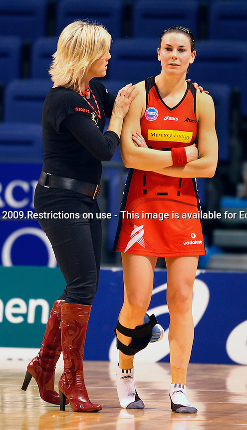 27.04.2009 Helen Mahon-Stroud coach of the Tactix comforts Maree Bowden after the ANZ Championship Netball Match between the Tactix and Adelaide Thunderbirds at Westpac Arena in Christchurch. Mandatory Photo Credit (Pic. Martin Hunter) ©Michael Bradley  Photography.