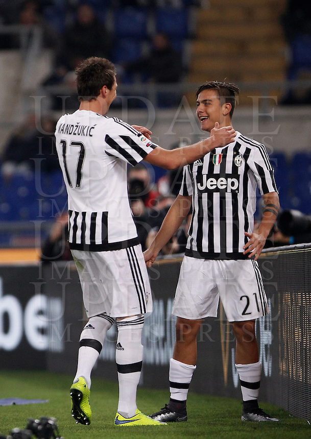 Calcio, Serie A: Lazio vs Juventus. Roma, stadio Olimpico, 4 dicembre 2015.<br /> Juventus' Paulo Dybala, right, celebrates with teammate Mario Mandzukic after Lazio's Santiago Gentiletti scored an own goal during the Italian Serie A football match between Lazio and Juventus at Rome's Olympic stadium, 4 December 2015.<br /> UPDATE IMAGES PRESS/Isabella Bonotto