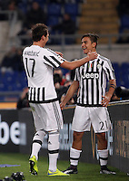 Calcio, Serie A: Lazio vs Juventus. Roma, stadio Olimpico, 4 dicembre 2015.<br /> Juventus&rsquo; Paulo Dybala, right, celebrates with teammate Mario Mandzukic after Lazio&rsquo;s Santiago Gentiletti scored an own goal during the Italian Serie A football match between Lazio and Juventus at Rome's Olympic stadium, 4 December 2015.<br /> UPDATE IMAGES PRESS/Isabella Bonotto