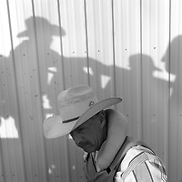 Shadows play on the wall of the announcer's booth at a rodeo arena in Brush, Colo.