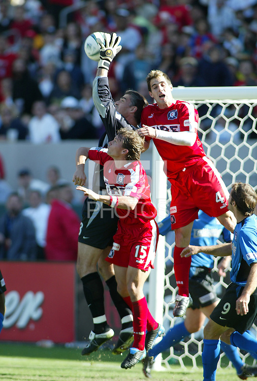 San Jose Earthquakes' Pat Onstad grabs a ball in front of Chicago Fire's Carlos Bocanegra (4) and Jesse Marsch (15) in the2003  MLS Championship, in Carson, Calif.