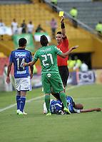 BOGOTA - COLOMBIA -07 -03-2015: Harold Perilla (Der.), arbitro, muestra tarjeta amarilla a Juan Villota (Cent.) jugador de La Equidad,durante partido entre Millonarios y La Equidad por la fecha 8 de la Liga Aguila I-2015, jugado en el estadio Nemesio Camacho El Campin de la ciudad de Bogota. / Harold Perilla (R), referee, shows yellow card to Juan Villota (C) player of La Equidad, during a match between Millonarios and La Equidad for the date 8 of the Liga Aguila I-2015 at the Nemesio Camacho El Campin Stadium in Bogota city, Photo: VizzorImage / Luis Ramirez / Staff.
