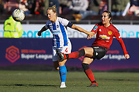 Danielle Buet of Brighton & Hove Albion Women and Katie Zelem of Manchester United Women during Brighton & Hove Albion Women vs Manchester United Women, SSE Women's FA Cup Football at Broadfield Stadium on 3rd February 2019