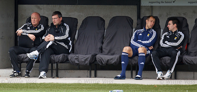 Peter Houston and Craig Levein watch the players on the park as Steven Whittaker sits out the session with the Scotland Physio