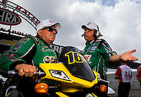 Aug 31, 2014; Clermont, IN, USA; NHRA  funny car driver John Force (left) talks with crew chief Jimmy Prock during qualifying for the US Nationals at Lucas Oil Raceway. Mandatory Credit: Mark J. Rebilas-USA TODAY Sports
