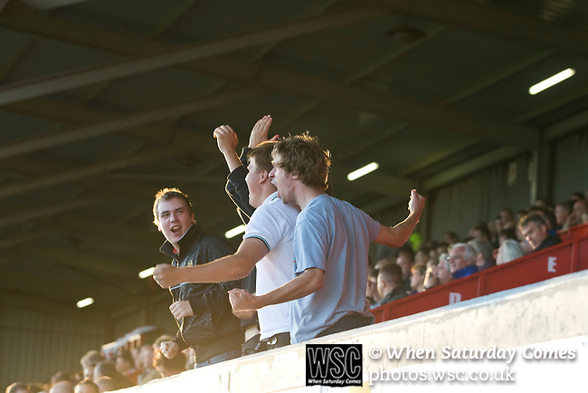 Bangor City 0 FC Honka 1, 23/07/2009. Racecourse Ground, Europa League. The five travelling supporters of FC Honka from Finland celebrating their team's goal at Wrexham's Racecourse Ground, the venue for their sides Europa League second round second leg tie against Welsh club Bangor City. The match had to be staged away from City's Farrar Road ground as it did not meet UEFA's stadium standards. The Finns won 1-0 in Wales to go through 3-0 on aggregate in front of 602 spectators in the first season of the newly-introduced competition which replaced the UEFA Cup. Photo by Colin McPherson.