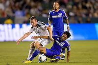 LA Galaxy midfielder Chris Birchall and Kansas City Wizard midfielder Stephane Auvray battle. The Kansas City Wizards beat the LA Galaxy 2-0 at Home Depot Center stadium in Carson, California on Saturday August 28, 2010.