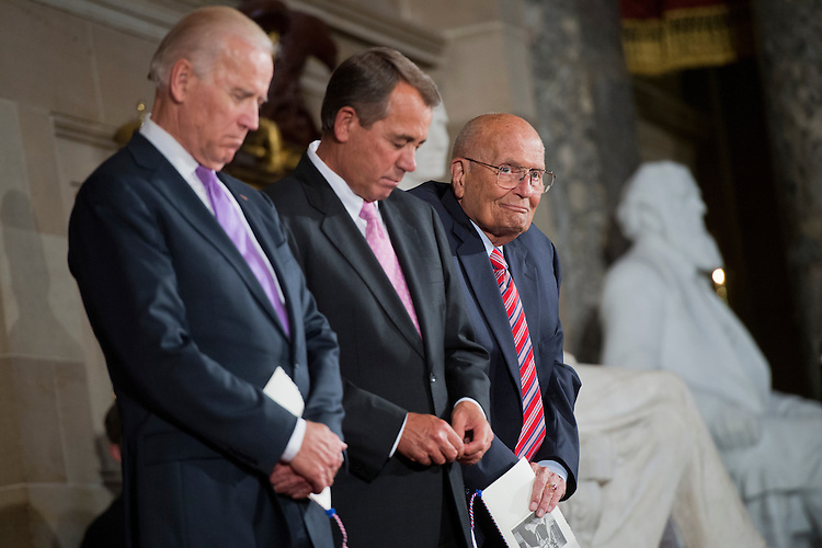 UNITED STATES - JUNE 13: Rep. John Dingell, D-Mich., right, is pictured with Vice President Joe Biden, left, and Speaker John Boehner, R-Ohio, in the Capitol's Statuary Hall during a ceremony to honor Dingell as the longest serving member of Congress. He came to Congress in 1955, filling his father's seat. (Photo By Tom Williams/CQ Roll Call)